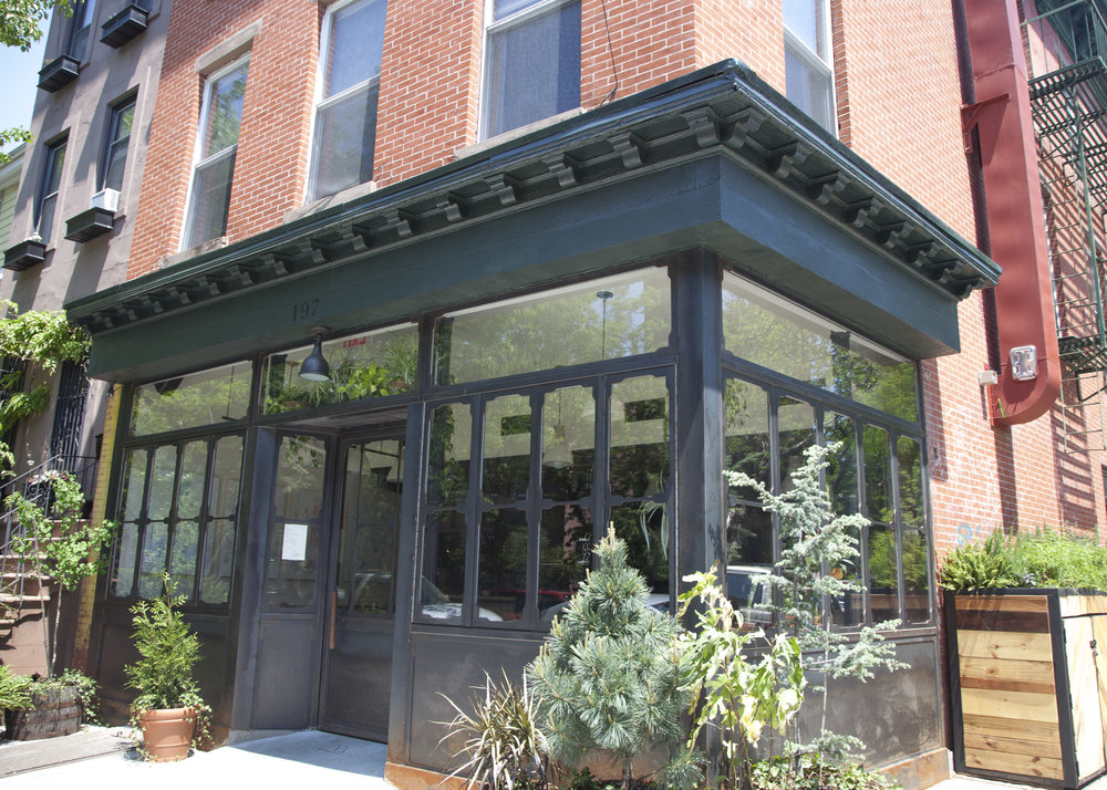 Metta is located in Fort Greene, at the corner of Adelphi Street and Willoughby Avenue.