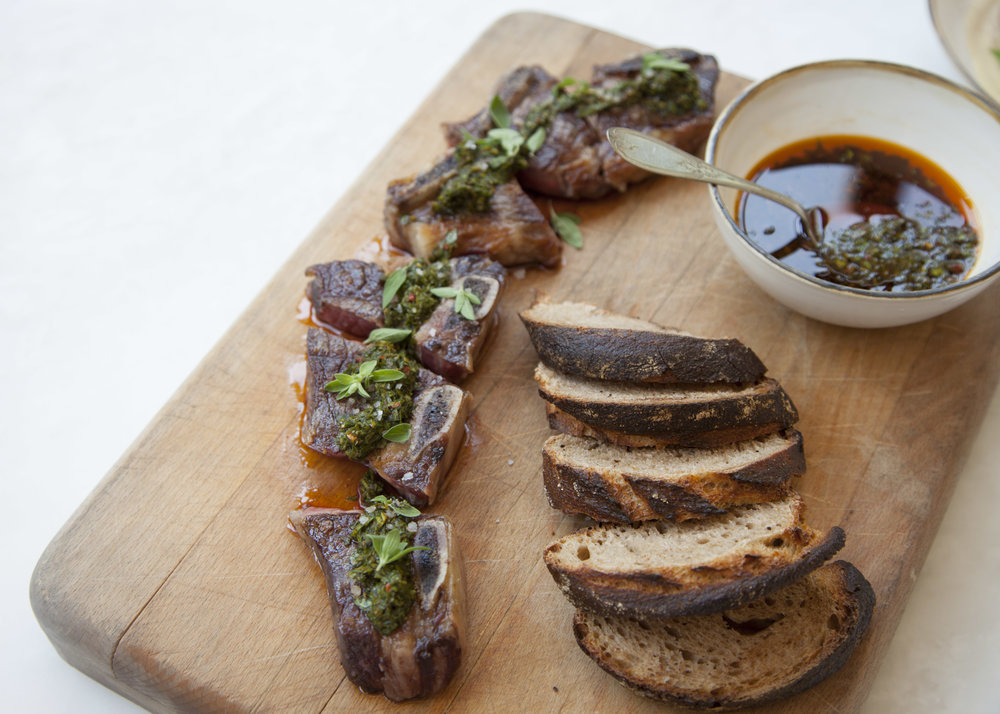 Grilled short rib steak served with chimichurri and house-made sourdough bread.