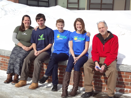 Scholarship recipients pose in their new T3 & Chewonki t-shirts after being recognized at a school assembly; (left to right) Chewonki representative Prema Long, Josh Kramley, Carol Leone of Teens To Trails, Gabby Chapman, and Wiscasset Outing Club Advisor Ralph Keyes