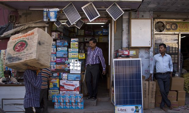 Solar panels for sale at a market in New Delhi. India's solar power prices have fallen to 2.62 rupees per kilowatt hour. Photograph: Saurabh Das/AP