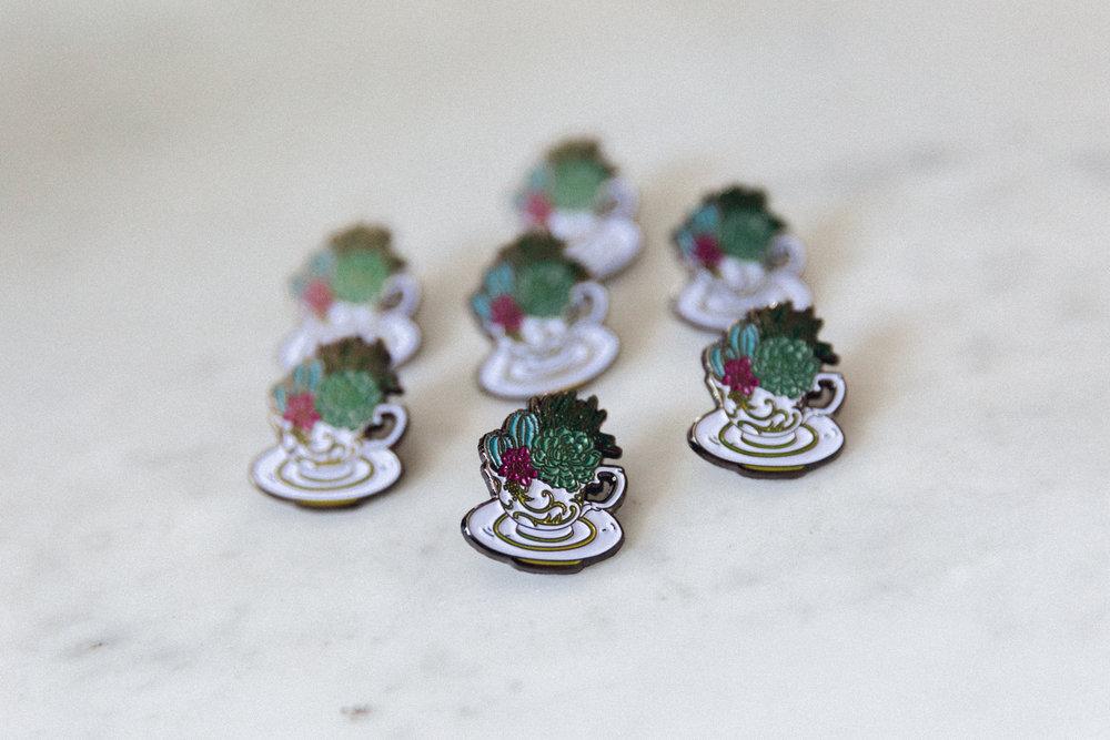 O'Berry's Succulents Teacup Succulent Enamel Pins. Design by Anna  Núñez . Photography by Bridge + Bloom.