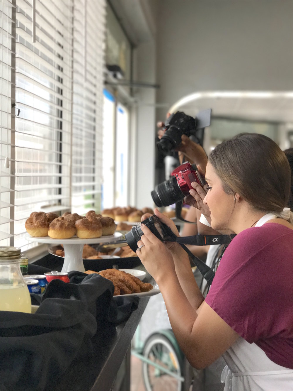The camera always eats first! Annie Pyle of Discovering Your Happy snapping the perfect pic of the savory spread Chef Rosana prepared for us to enjoy while our baguettes proofed and baked. Everything was delicious, including the Empanadas & Kouign-Amanns.