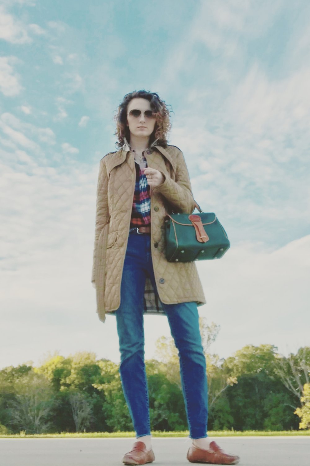 Sunglasses: Ray-Ban; Flannel shirt and coat: Barbour; Purse: Dooney & Bourke All Weather Leather (Vintage); Belt: H&M; Jeans: Lucky Brand; Shoes: Cole Haan.