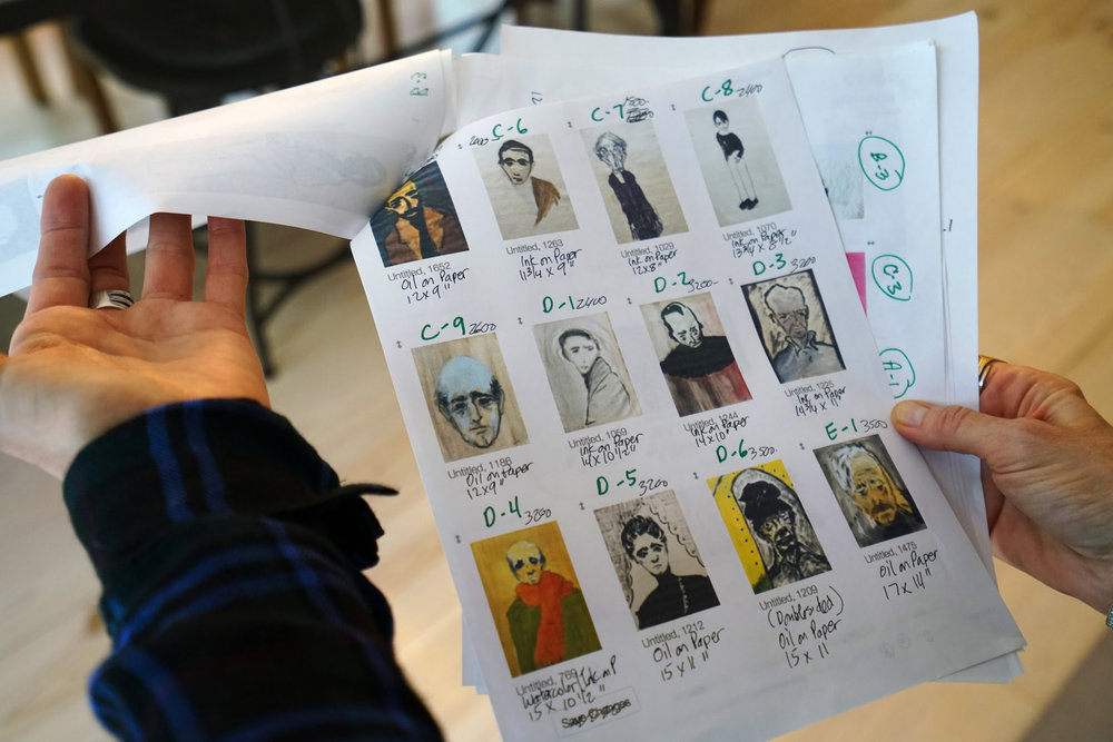 A worksheet of the portraits by Mr. Heming that will be on display. Nicole Bengiveno for The New York Times