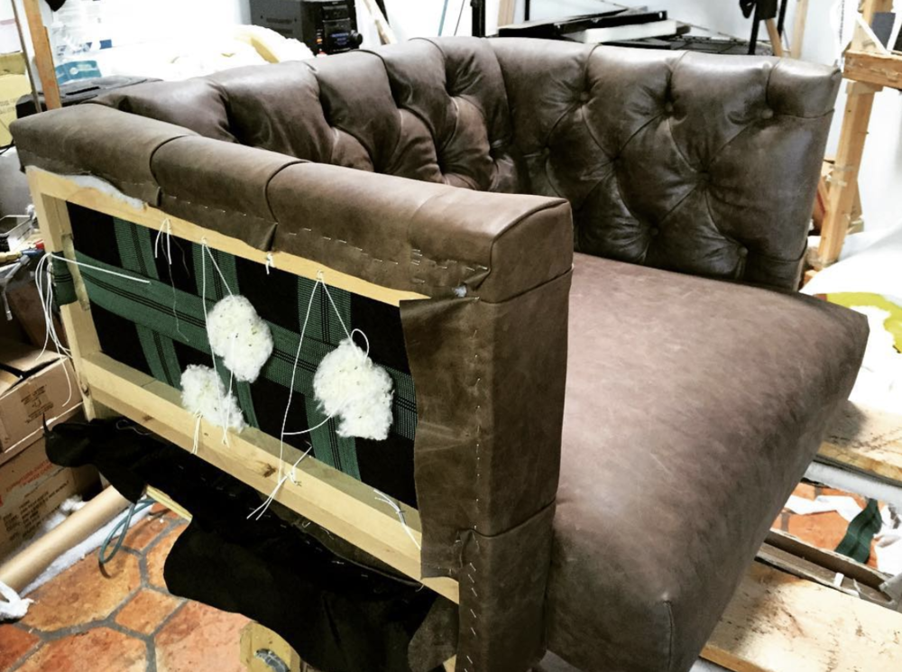 - Tufted leather cushion fabricated by local craftsmen
