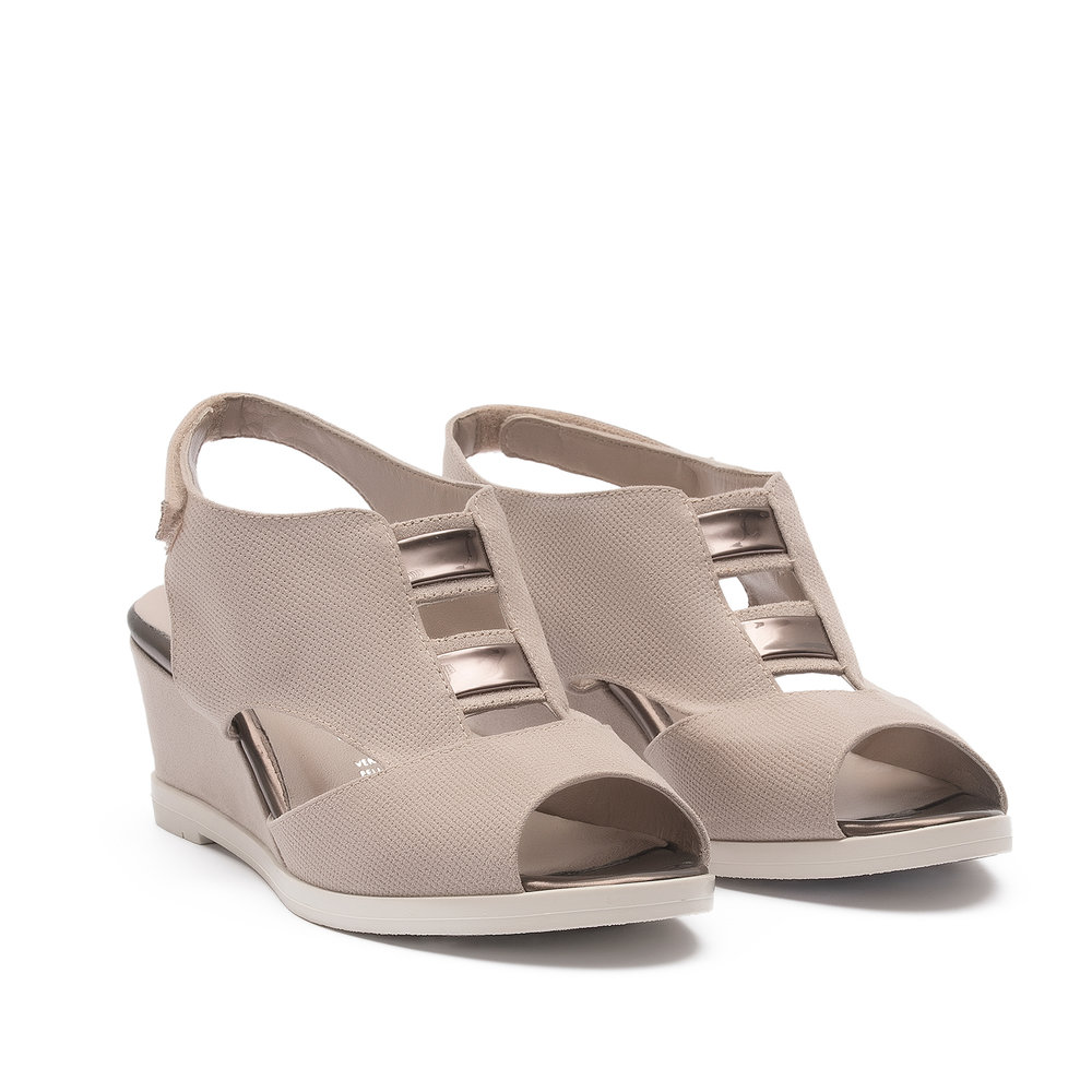 551893 - Sandal with upper in punched beige fabric suede with details in platinum-coloured mirrored laminate, covered wedge heel and ice-coloured sole.