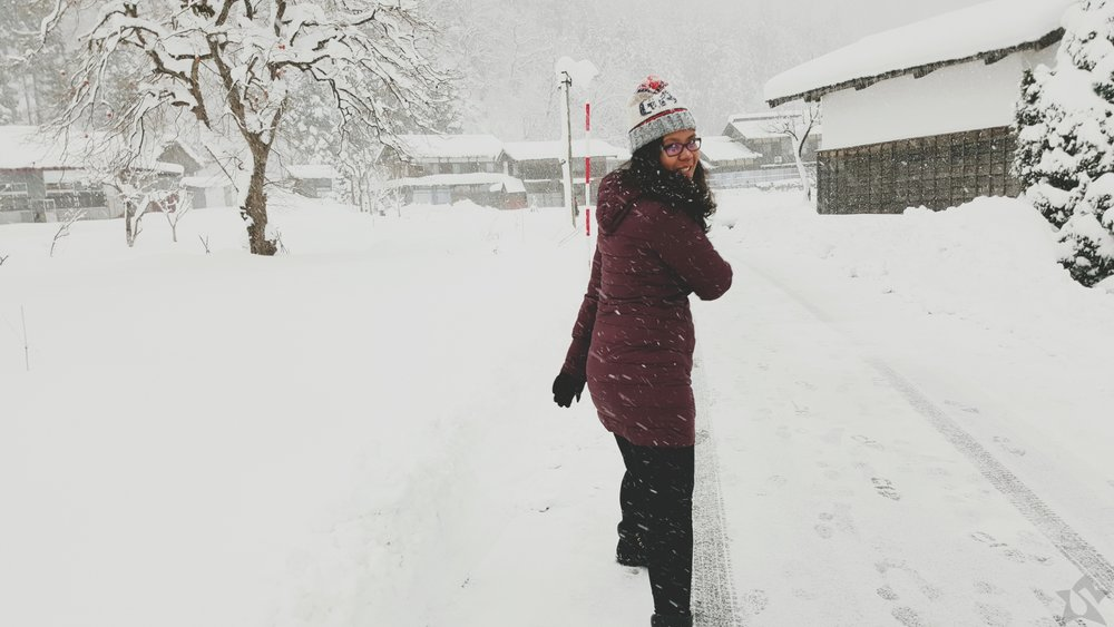 Girl in a Snowfall in Shirakawago Japan