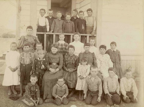 This class picture is of Annie Sullivan and her students in 1893. The Museum has the original School Register for the years 1892-1894. When this picture was taken she had 28 children in grades one through seven.