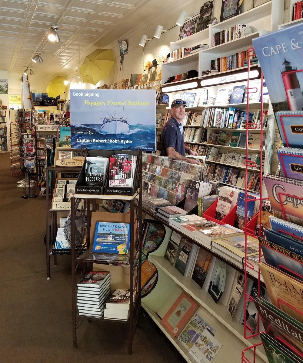 Emily's gentleman caller - aka Jim - exploring Yellow Umbrella Books in Chatham, MA
