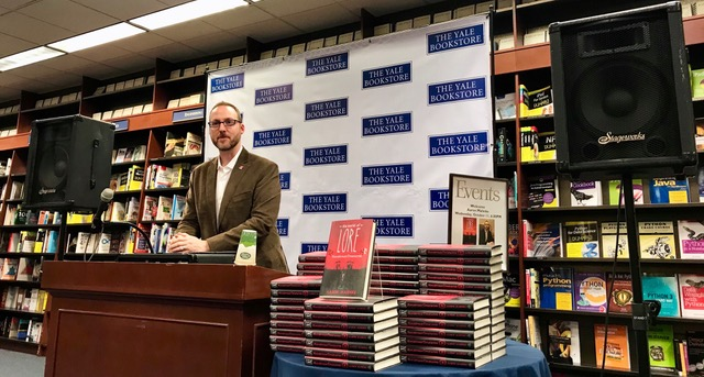 Aaron Mahnke host of the Lore podcast discussing his book The World of Lore: Monstrous Creatures at the Yale Bookstore.
