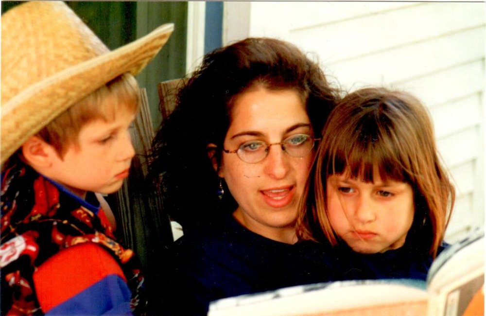 Emily reading to her kids, Rachel and Jacob, circa 1996.