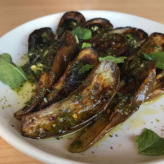 Local Fairytale eggplant 🍆 marinated in roasted garlic orange and oregano then roasted and topped with a mint salsa verde  #woodfiredoven #eatlocal #eatit #downtowntucson