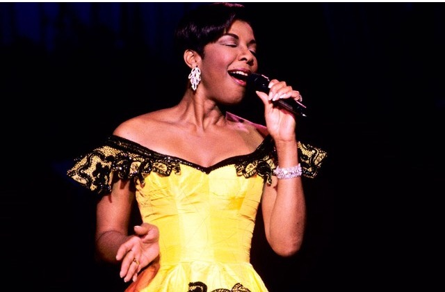Natalie Cole wears a Fabrice Simon dress while performing at the Grammy Awards