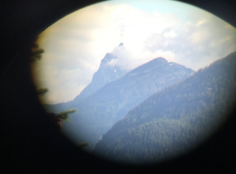 I took this shot of the peak, through binoculars, from the highway through the North Cascades.