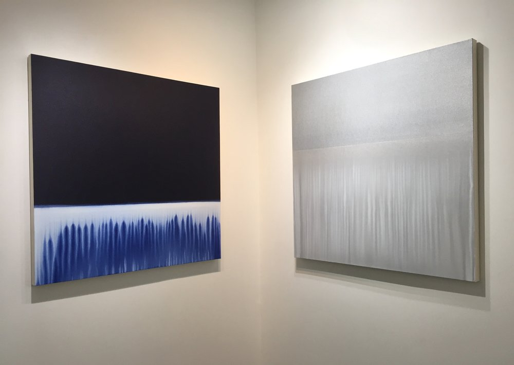 "Indigo Flow 6   &   Silver Flow  , 2018, acrylic on unprimed canvas, 42"" x 42"" each."