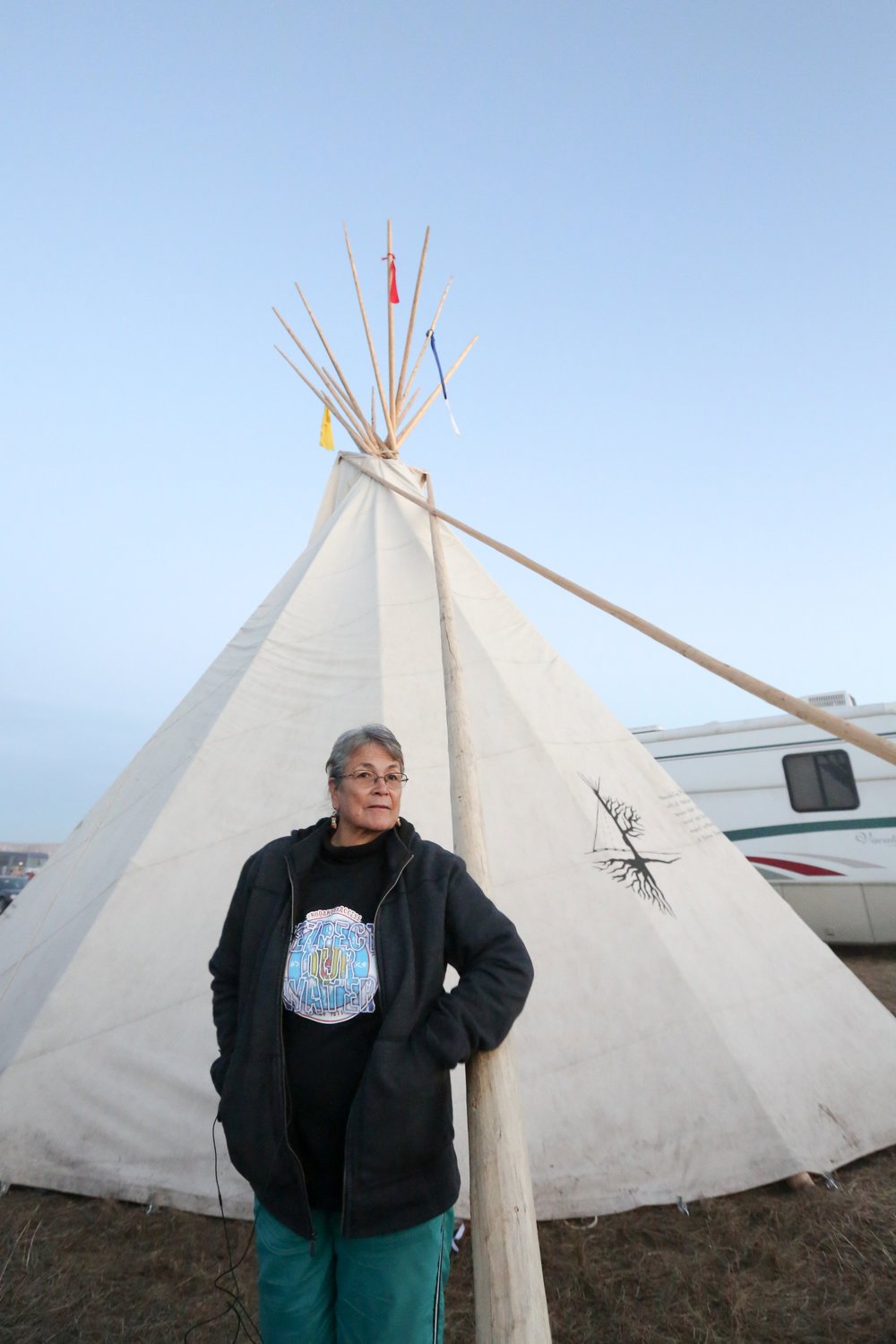 Betty Archambault stands in front of the tepee housing the Montessori school she started at Oceti Sakowin Camp. Photo by Heather Wilson