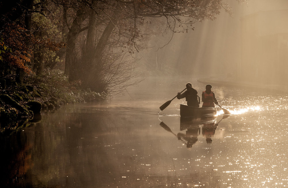 Canoeists in the mist