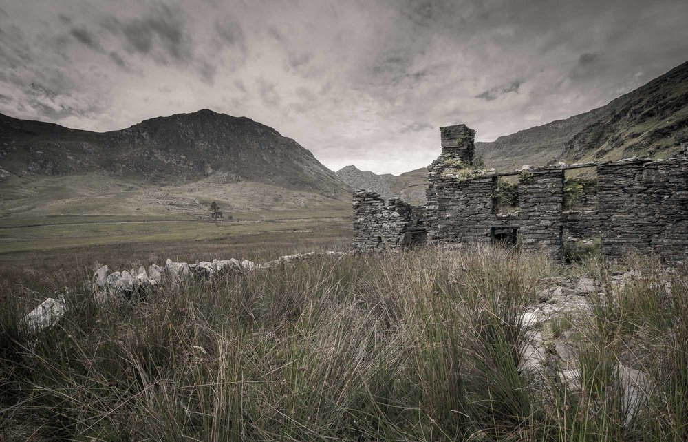 Ruined slate house with mountain