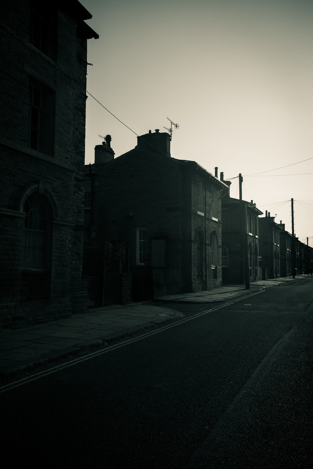 Saltaire street at dusk in monochrome