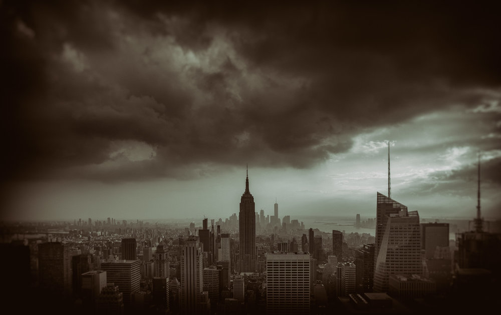 Dusk over Manhattan skyline with dramatic cloud