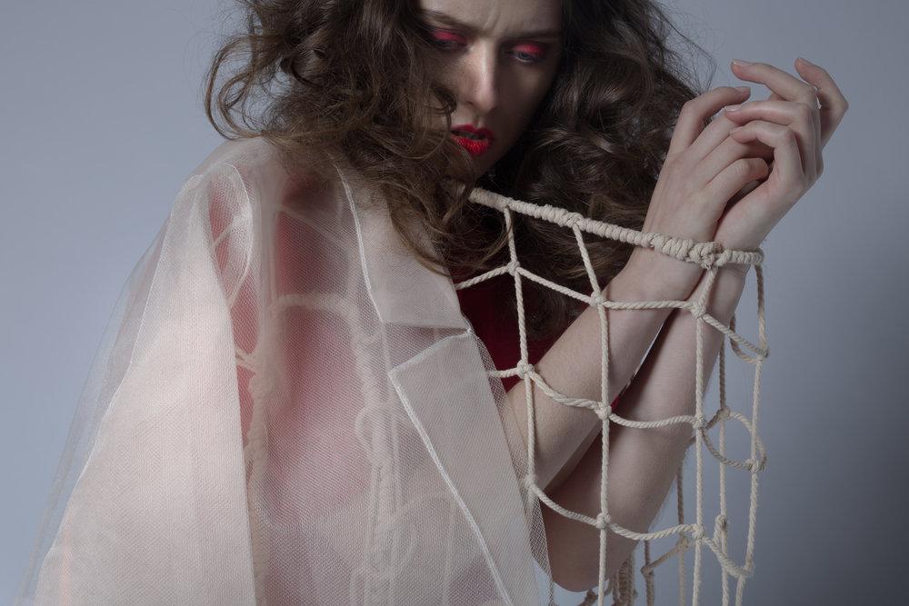 Francesca Longo Rochambeau (poncho)  Makeup: Xiaofeng Zhu Hair: Lea Deloy Model: Inga Khurieva Photographer: Anushila Shaw