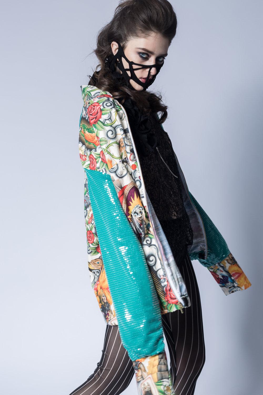 Keiko Koakutsu (jacket) Keiko Koakutsu (mask) Tights (Daniel Silverstain)  Makeup: Xiaofeng Zhu Hair: Lea Deloy Model: Inga Khurieva Photographer: Anushila Shaw