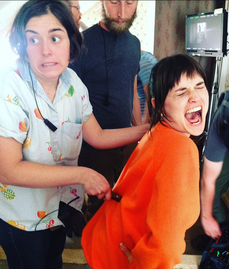 8 - Our props head Erica pretending to stab our actress Flora on set.jpg