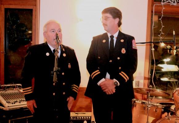Butch Sutherland congratulates Dave Green.