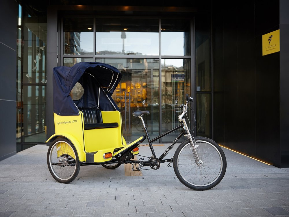 L7 offers rickshaw rides to get a tour of the city by a local - a collaboration with pedicab service ARTEE