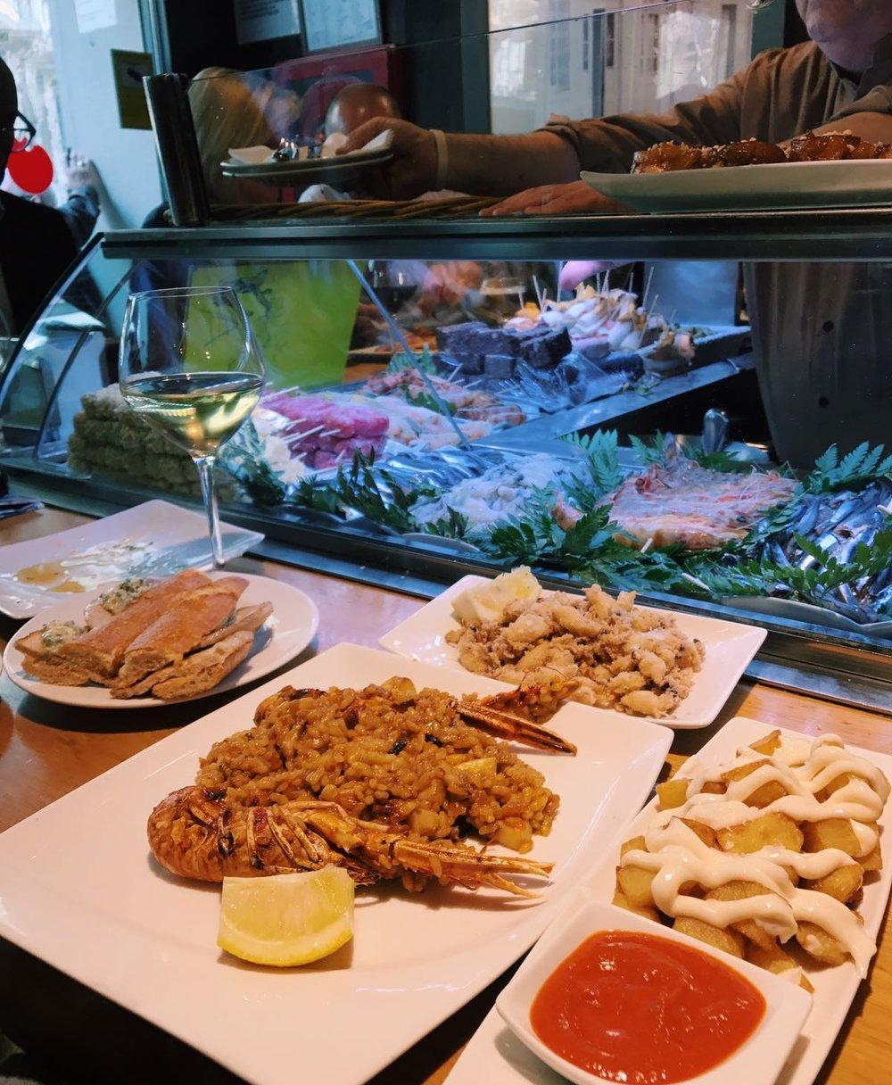 From left: Pork sandwich, Paella, Fried calamari, those addictive potatoes!