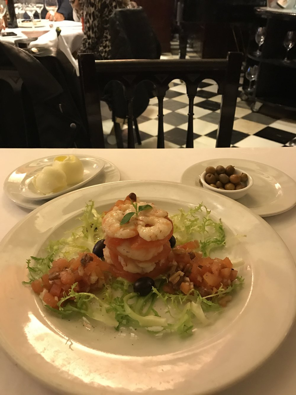 The delightful and fresh salad of king prawns with caramelized tomato and truffle oil