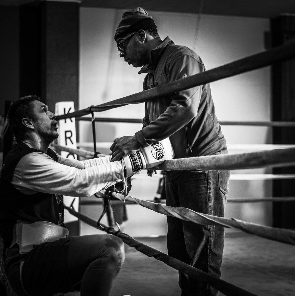 Cruiserweight contender Alexey Zubov getting advice from  Sugar Hill Steward