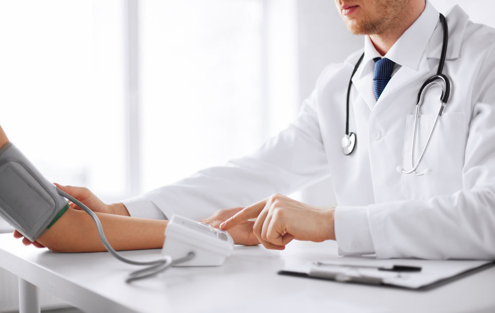stock-photo-healthcare-hospital-and-medicine-concept-doctor-and-patient-measuring-blood-pressure-152657846.jpg