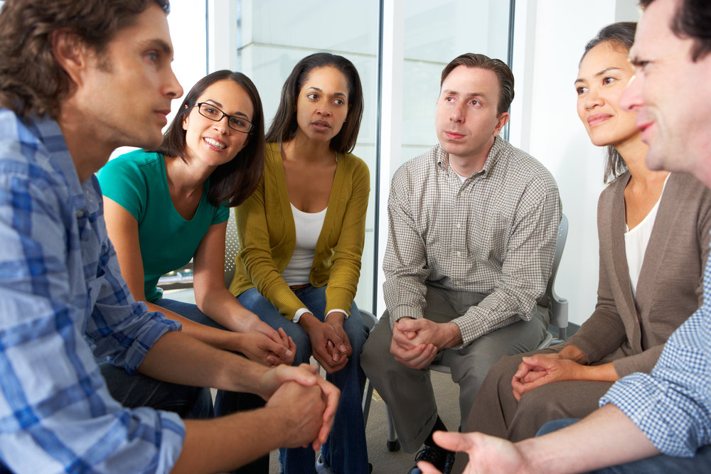 stock-photo-meeting-of-support-group-141036163.jpg