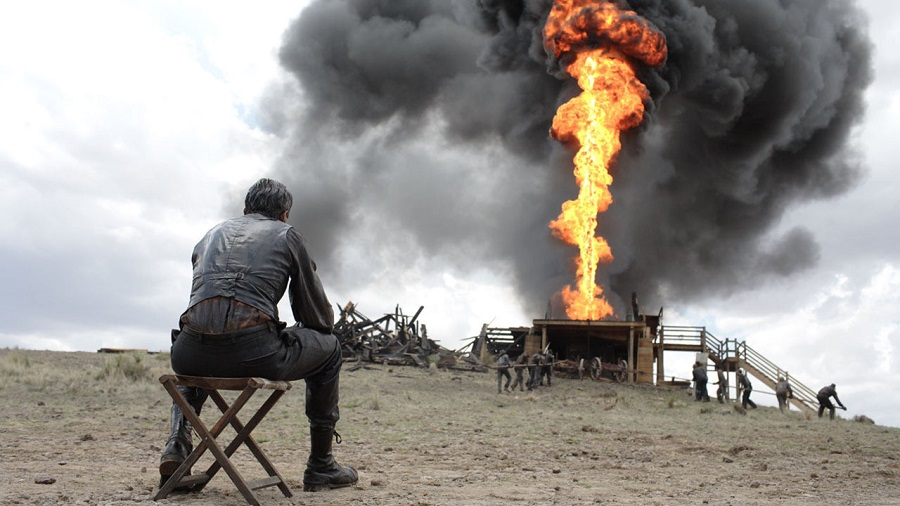 Peak Oil: Daniel Day-Lewis (Daniel Plainview, seated) in  There Will Be Blood