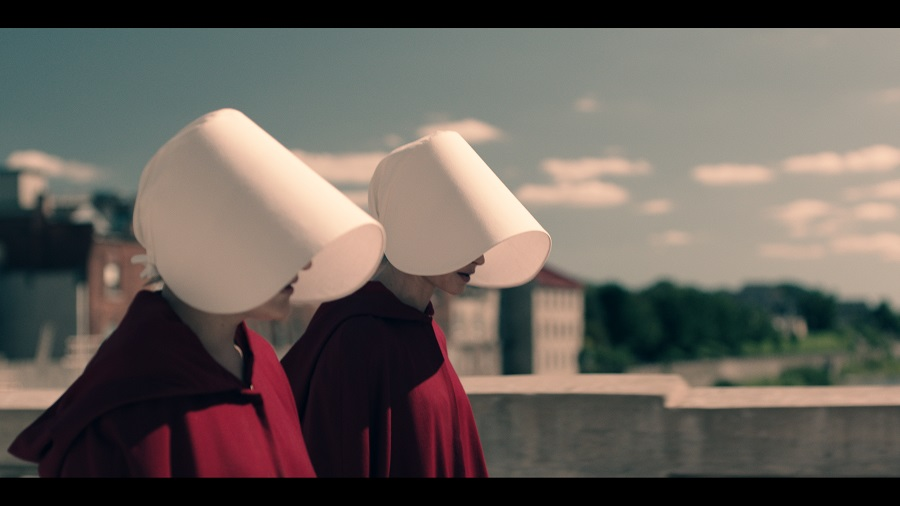 Captives: Elisabeth Moss (Offred) and Alexis Bledel (Ofglen) in SBS on Demand's  The Handmaid's Tale