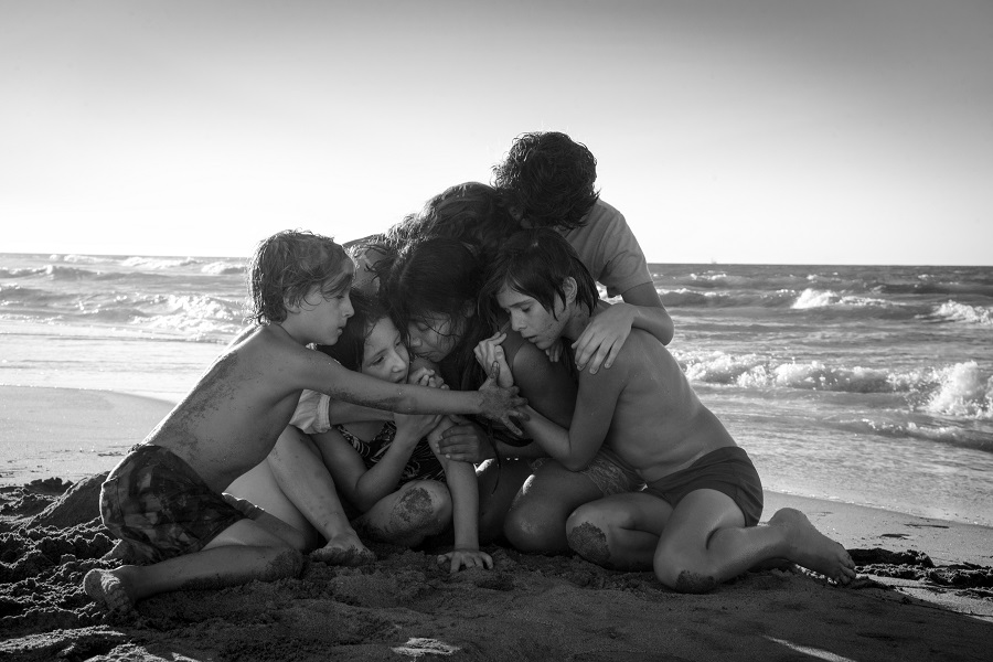 On the Beach: Cleo (Yalitza Aparicio) and her young wards in  Roma