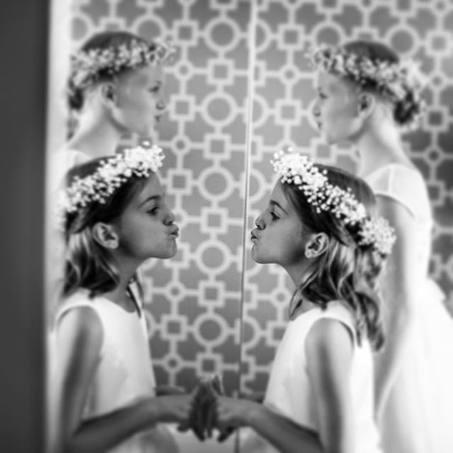 Brides aren't the only ones doing a double check in the mirror before the big walk.  #flowergirls #torontoweddingphotography #canon📸