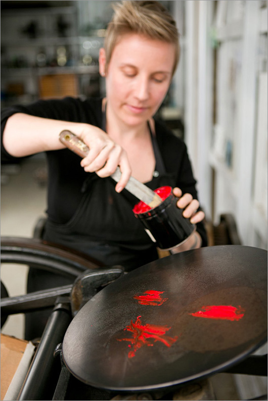 Nicole spreads her soya-based ink over George's platen...