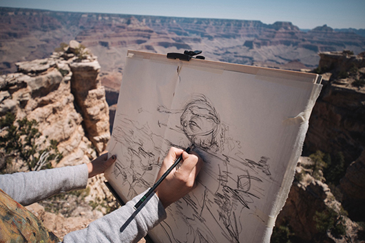 Welsh sketches one of her creatures while overlooking the Grand Canyon in Las Vegas, United States. Credit: Andy Faraday.