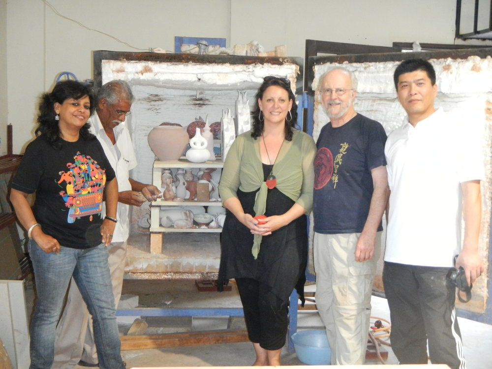 Packing the kiln with artists from India, China and the United States