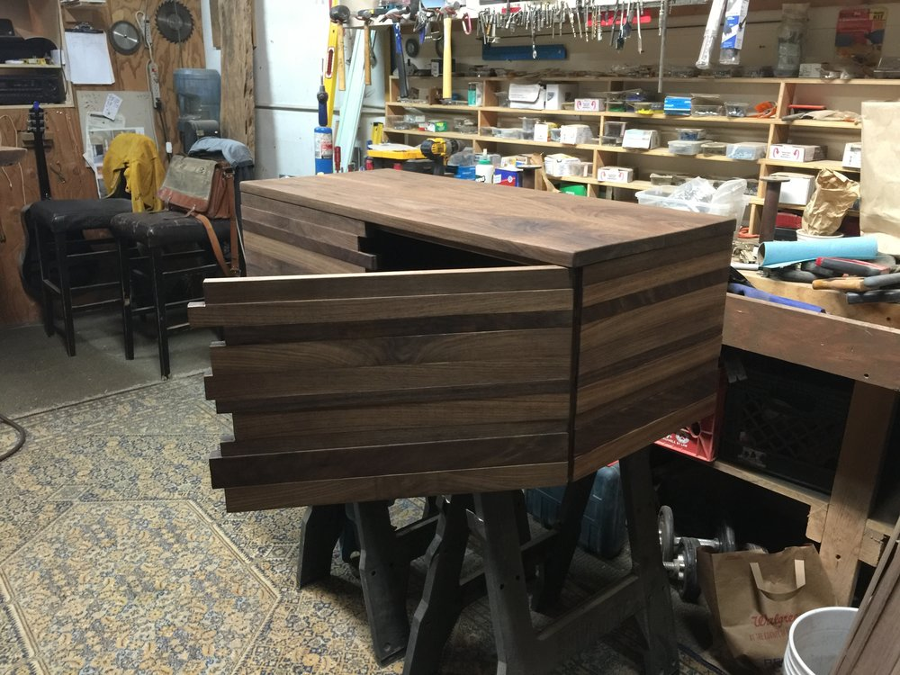 "A matching walnut entertainment center with ""hidden"" doors"