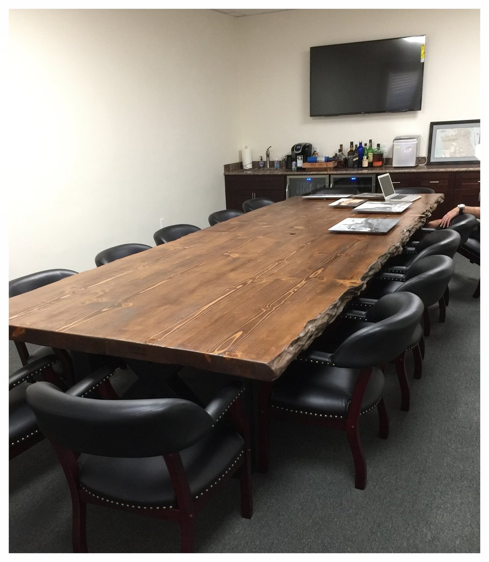 Made from old pilings from the SF Bay this massive conference table is one of a kind.