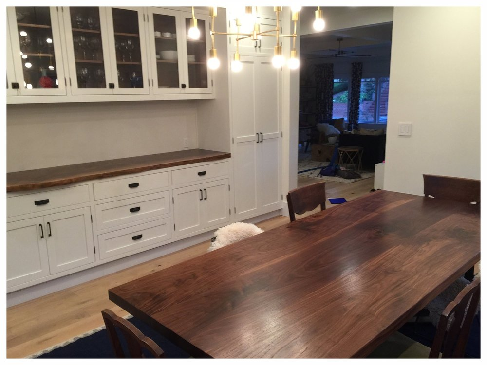 A solid walnut dining table with matching countertop