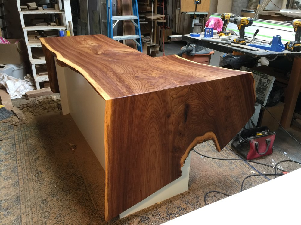 Waterfall edges transform this huge piece of American Elm to a one of a kind countertop for Urban Remedy.