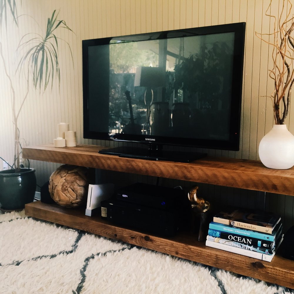 Reclaimed Cedar and salvaged steel become a beautiful entertainment center.