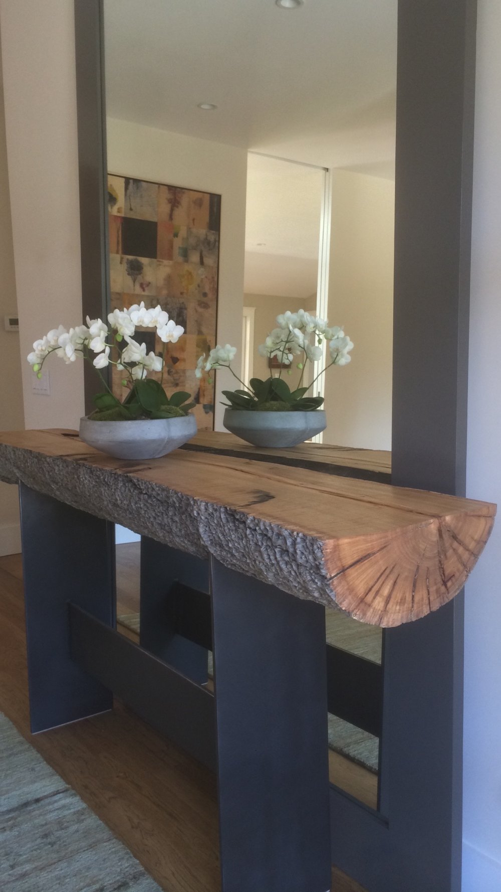 "Eucalyptus Pommele is as unique as a piece of wood comes. Combined with 1/2"" steel plate legs this console table is the epitome of a statement piece."