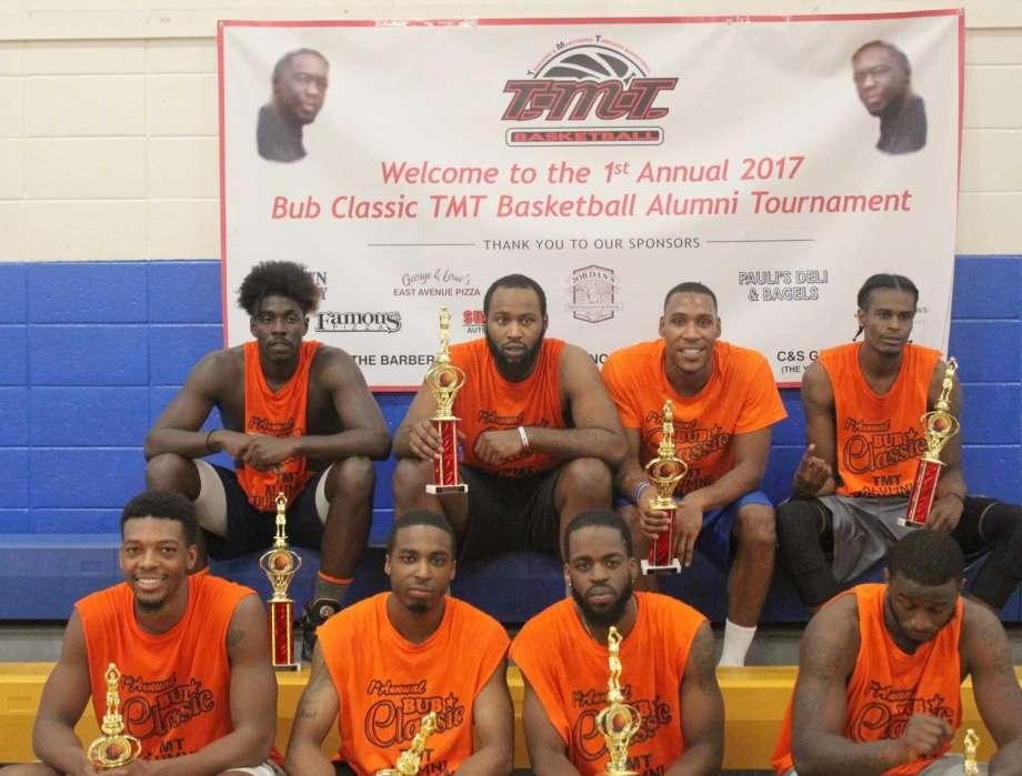 This team of TMT Basketball alumni won last weekend's tournament. From left: front row, Evan Kelly, John Boykin, Brian Wade and Moriba Keita; back row, Antwan Boyd, Lamar Tate, Takari Smalls and Tyler Shular.
