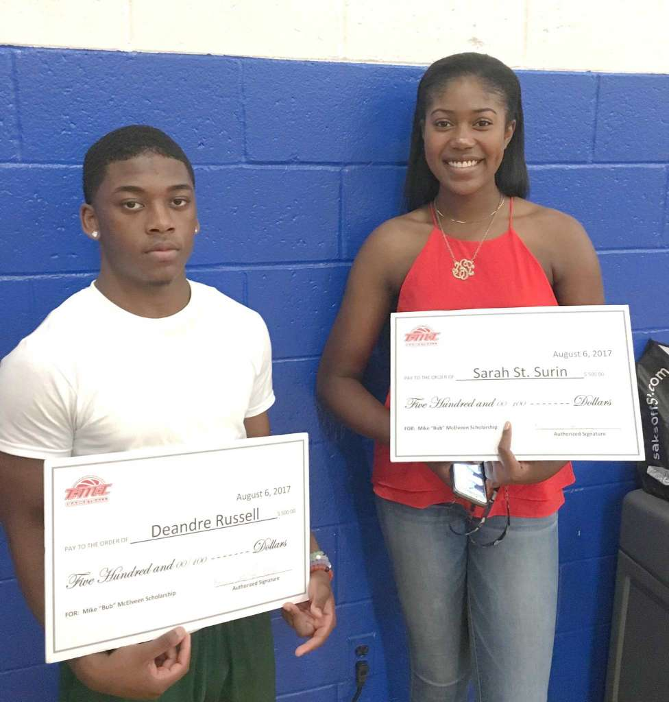 Norwalk High graduates Deandre Russell, left, and Sarah St. Surin were the recipients of $500 scholarships in honor of TMT Basketball founder Mike McElveen. The two were presented their scholarships as part of TMT's alumni weekend at Norwalk High and the Carver Center.