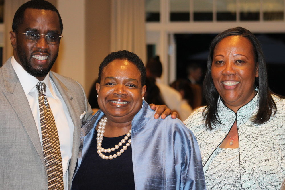 Child of America honoree, Sean Combs; Diana Napier, Carver Board President; Novelette Peterkin, Carver Executive Director